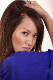 Young asian female model wearing purple dress