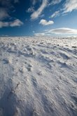 Snowy mountain scenery with deep blue sky