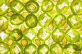set background in two layers of whole kiwi slices