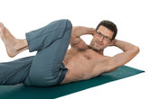 adult healthy man makes sports gymnastics isolated