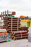 stacked different pipes for industry in a warehouse