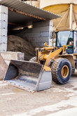 excavation wheel loader with big shovel in the construction industry in the open air