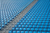 blue stadium seats and stairs