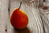 single pear on rustic wooden background