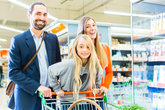 family with shopping trolley in a supermarket
