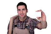 Carpenter with a business card left blank for your message