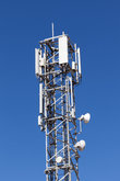 Communication tower with cellular network antennas