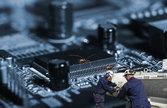 technicians fighting computer bugs