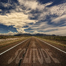 Conceptual Image of Road With the Word Solitude