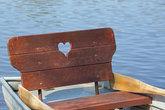 rowboat with heart at a lake