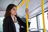 Businesswoman Traveling By Public Transport