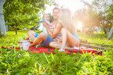 Happy family enjoying a picnic outdoors