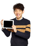 Handsome young Asian man using tablet / pad