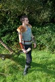 medieval dressed man in nature,keeps drinking horn in hand