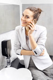 call. business woman talking on the phone in a corporate toilet.