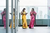 Indian women using modern technology for communication during the break