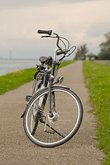 Bicycle on the road along the river