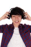 Asian man listen to music.