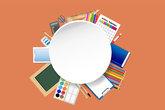 School supplies around the empty white circular plate