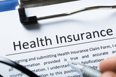 High Angle View Of Health Insurance Form