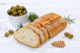 Ciabatta bread with olives food on wooden plate