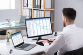 Businessman Analyzing Gantt Chart On Computer