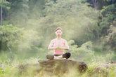 young beautiful asian woman practicing yoga