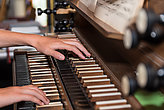 Person plays church organ - detail