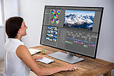 Editor Editing Video On Computer