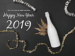 New Year's background with a bottle of champagne and various New Year's utensils on black chalkboard