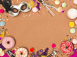 colorful brown carnival background with donuts and other funny carnival items