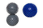 Massage ball or hedgehog ball. Closeup of three spiky massage balls for health therapy isolated on a white background. Therapy and fitness equipment.