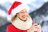 Girl on christmas holidays using smart phone