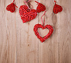 red hearts on a wooden background of oak boards