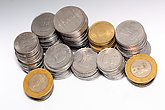 Stock pile of 5 and 10 Indian rupee metal coin currency on isolated white background. Financial, economy, investment concept. Banking and exchange object