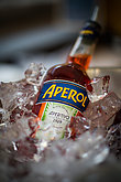Illustrative editorial image of an Aperol bottle in an ice bucke