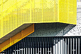 Industrial building facade with abstract geometric shapes and lines