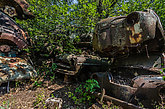 Rusted old car on a overgrown place